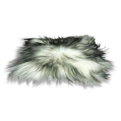 Stoelpad IJslandse schapenvacht wit met zwarte uiteinden