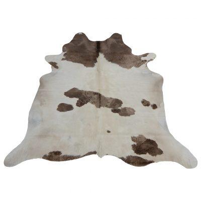 Wit koeienkleed met taupe vlekken