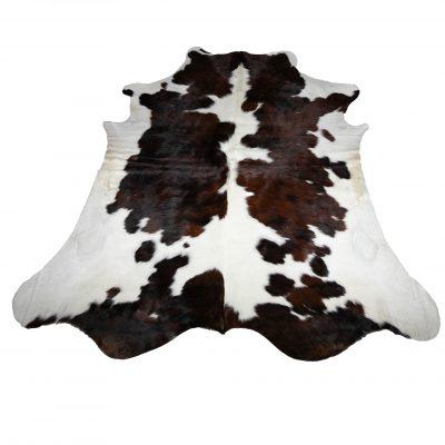 glanzende bruin witte koeienhuid